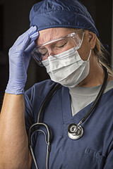 Stressed Female Doctor or Nurse Wearing Protective Wear