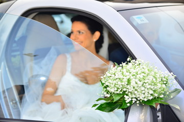 Bride going out of the car smiling