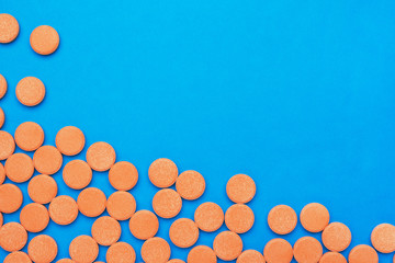 orange vitamin pills