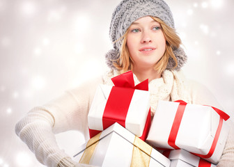 Happy Young Woman holding a lot of gift boxes