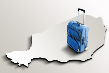 Travel to Niger. Blue suitcase on 3d map of the country