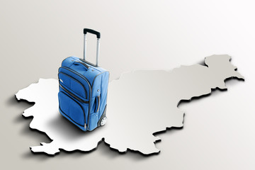 Travel to Slovenia. Blue suitcase on 3d map of the country