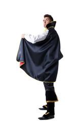 Studio shot of man dressed as illusionist