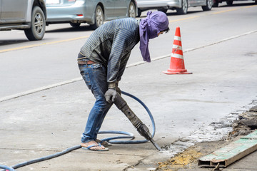 Road repairing works with jackhammer