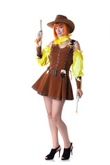 Pretty red-haired woman posing dressed as cowboy
