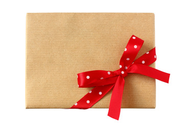 Geschenk verpackt mit roter Schleife