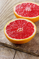 Grapefruit on a rustic wooden board
