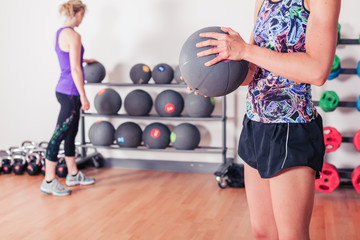 Young woman with medicine ball