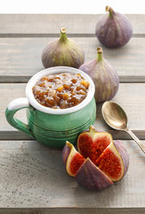 Jug of fig jam and bowl of fresh figs