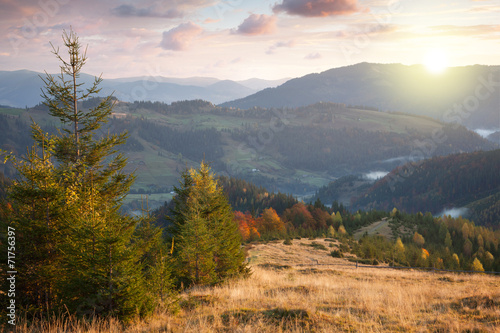 Beautiful Autumn in Mountains at sunset time. Trees,  peaks, clo - 71756397