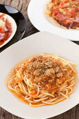 A portion of Italian spaghetti topped with minced pork in bologn