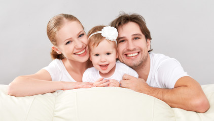 Happy family mother, father, child baby daughter at home
