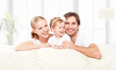 Happy family mother, father, child baby daughter