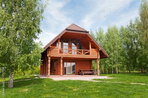 Leinwandbild Motiv Wooden cottage.