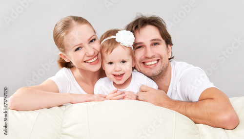 canvas print picture Happy family mother, father, child baby daughter at home