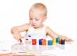 Little baby paint by his hands.