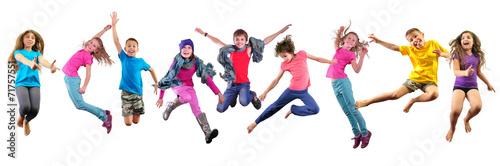 Leinwanddruck Bild happy children exercising and jumping over white