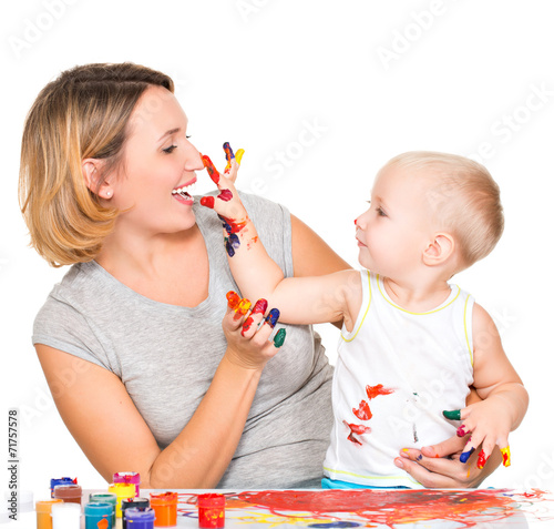 canvas print picture Happy child draws on the face of his mother.