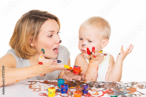 canvas print picture Happy young mother and child with painted hands.