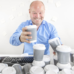 Business man drinks too much coffee