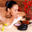 portrait of an adult beautiful woman relaxing in spa salon