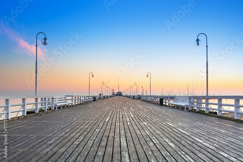 Fototapeta Sunrise at wooden pier in Sopot over Baltic sea, Poland
