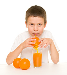 boy drink orange juice with a straw