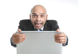 addict businessman in stress at laptop screaming desperate poster