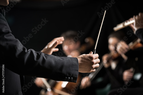 Orchestra conductor on stage - 71759386