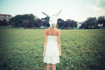 rabbit mask absurd beautiful young woman with white dress