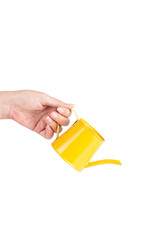 Hand with watering can isolated on white background