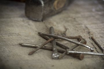 Old rusty nails on wooden background