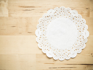 Lace paper on wooden table