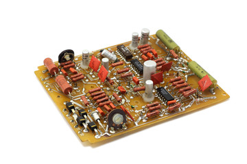 Old electronic circuit on a white background