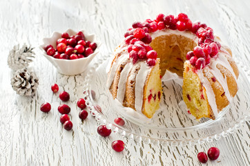 Homemade glazed cranberry cake with fresh berries  on a plate