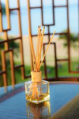 Incense sticks in the tank with oil