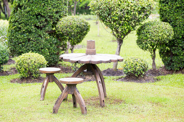 Wooden table and chairs in garden