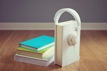 Book with white headphones