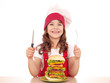 happy little girl cook with big hamburger on table