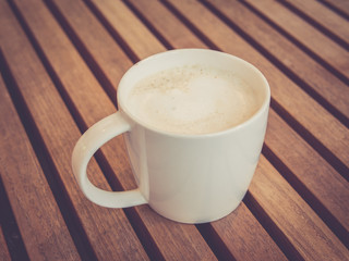 Hot latte with vintage filtered effect