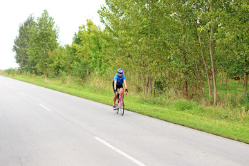 male cyclist on a fast race bike