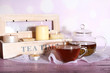 canvas print picture - Composition with tea in cup and teapot and candles