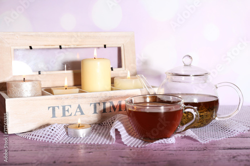 canvas print picture Composition with tea in cup and teapot and candles