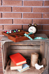 Sewing kit with tapeline, books, rope and toy bird