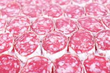 Slices of salami as background