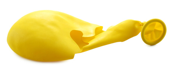 Popped yellow balloon isolated on white