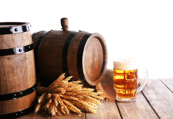 Beer barrel with beer glass on table on white background