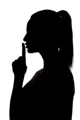 silhouette of woman holding finger on her lips