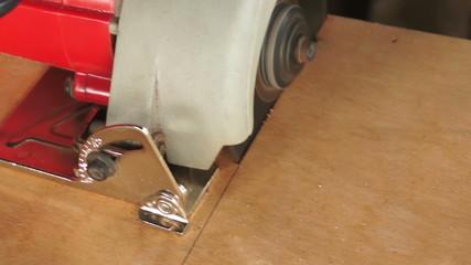 Carpenter working with circular saw, closeup