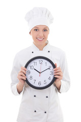 young woman chef in uniform holding office clock isolated on whi